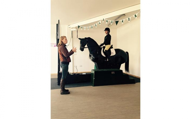 Demonstration by instructor Samantha Holt and Proprietor Wendy Ellis on 'Radar' the mechanical horse simulator