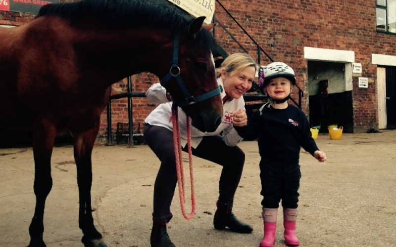 The youngest attendee of the day, 2 year old Leni-Rea sporting some of the BEF's free jodhpurs after signing up to come back riding with proprietor Christine Pillott